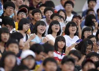 Spectators watch the long jump event of the heptathlon at the IAAF World Championships in Daegu