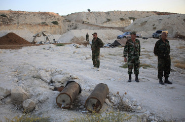 Forces loyal to Syria's President Bashar al-Assad inspect an underground base dug by rebel fighters in al-Hareeqa village, after the forces said they have regained control of the area in Hama countryside