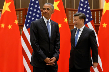 U.S. President Barack Obama and China's President Xi Jinping arrive for a bilateral meeting ahead of the G20 Summit, at West Lake State Guest House in Hangzhou
