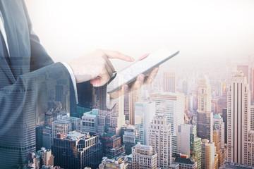 Businessman using tablet multiexposure
