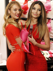 Victoria's Secret Angels Candice Swanepoel and Lily Aldridge pose during a photo opportunity for the 2013 Valentine's Day sale at the Victoria's Secret flagship store in New York
