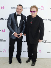 Producer David Furnish and partner musician Elton John arrive at the 19th Annual Elton John AIDS Foundation Academy Award Viewing Party in West Hollywood, California