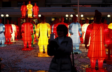 A woman takes a selfie next to 80 life-size models of the Terracotta Army during a celebration for the upcoming Chinese New Year at Zagreb's main square, Croatia