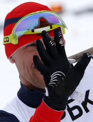 Russia's Petushkov celebrates his fifth gold medal of the Sochi Paralympics, after the men's 15 km sitting biathlon at the 2014 Sochi Paralympic Winter Games in Rosa Khutor