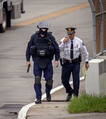 Police maintain a cordon after the Fox45 television station was evacuated due to a bomb threat in Baltimore