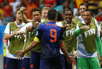 Robin van Persie of the Netherlands celebrates his goal against Spain with his teammates during their 2014 World Cup Group B soccer match at the Fonte Nova arena in Salvador