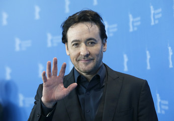 Actor Cusack poses during photocall at 66th Berlinale International Film Festival