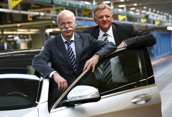 Zetsche, CEO of German carmaker Daimler, and Mercedes production boss Renschler pose with a new Mercedes-Benz S400 hybrid car in Sindelfingen
