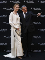 Actress Uma Thurman, wearing Bulgari jewellery worth 30 million yen ($295,470), poses for pictures with Bulgari CEO Jean-Christophe Babin during the Bulgari 130th anniversary party in Tokyo