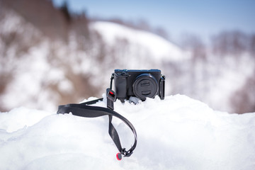 camera and winter time with mountain covered snow on background at japan.Concept travel in japan