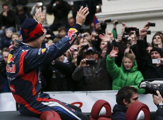 Red Bull Formula One driver Vettel of Germany waves to fans in Graz