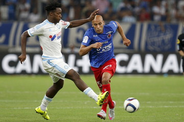 Olympique Marseille's Batshuayi challenges Caen's Yahia during their French Ligue 1 soccer match at the Velodrome Stadium in Marseille