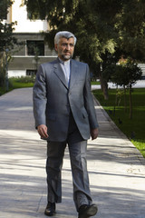 Iran's chief nuclear negotiator Saeed Jalili arrives for a news conference in Tehran