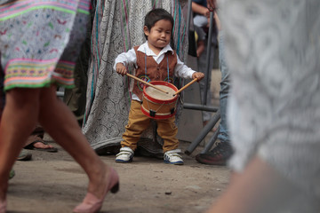 A child member of Cantagallo, an Indigenous Shipibo-Konibo community, playS the drums during a visit of Peru's President Pedro Pablo Kuczynski, in Lima