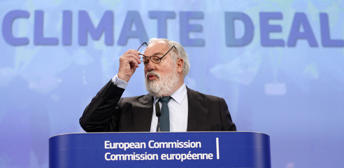 EU Commissioner Canete addresses a news conference in Brussels