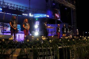 """Members of """"Viva La Musica the music"""" the music band of late Congolese musician Papa Wemba prepare to perform during an official ceremony held by the Ivorian government and music festival organizers to honor Papa Wemba in Abidjan"""