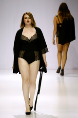 Models present creations as part of La Redoute plus size fashion boutique collection during Moscow Fashion Week in Moscow