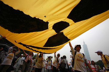 Activists carry a banner during an anti-nuclear protest in Taipei