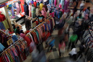 Shoppers flock to the Tanah Abang traditional market ahead of next week's Eid al-Fitr holiday marking the end of Ramadan in Jakarta