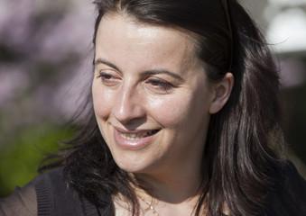 Head of Europe Ecologie-Les Verts Green Party Duflot walks near apple trees