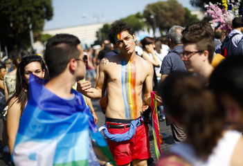 People walk during the annual gay pride parade in downtown Rome