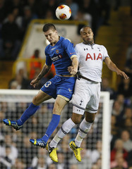Tottenham Hotspur's Kaboul is challenged by Tromso's Ondrasek during their Europa League soccer match in London
