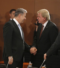 Berlin mayor Wowereit chats with state premier Bouffier of Hesse during prime ministers meeting in Berlin