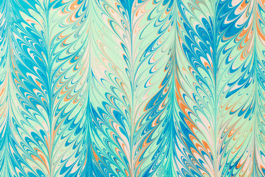 acrylic color marbling art pattern on paper background..