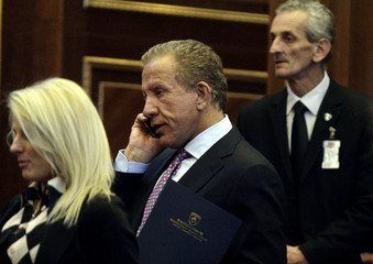 President of the AKR (Alliance for New Kosovo) party, businessman Behgjet Pacolli, attends the first session of the newly elected parliament in Pristina