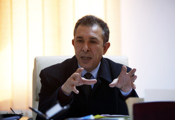 Jamal El-Shibani, head of the state Price Stabilisation Fund (PSF), speaks during an interview with Reuters in Tripoli