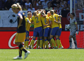 Sweden's players celebrate second goal against Australia during their Women's World Cup quarter-final soccer match in Augsburg