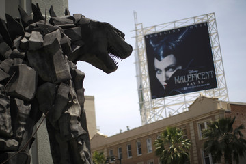 A statue of movie monster Godzilla stands in front of the TCL Chinese Theatre IMAX on Hollywood Boulevard in California