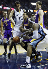 Los Angeles Lakers Barnes loses a ball under pressure from Memphis Grizzlies Haddadi of Iran and Cunningham during the second half of NBA basketball action in Memphis
