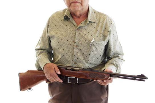 """A 69-year old man holds a 22 mm calibre rifle before turning it in during the """"Voluntary Disarmament Programme"""" in San Nicolas in Monterrey"""