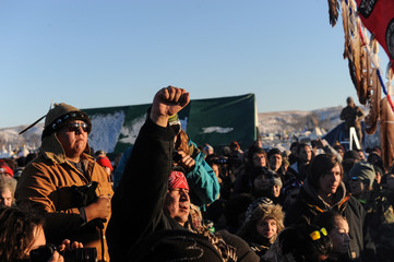 "People celebrate in Oceti Sakowin camp as ""water protectors"" continue to demonstrate against plans to pass the Dakota Access pipeline near the Standing Rock Indian Reservation, near Cannon Ball, North Dakota, U.S."