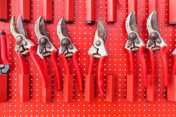 Row of red used garden shears
