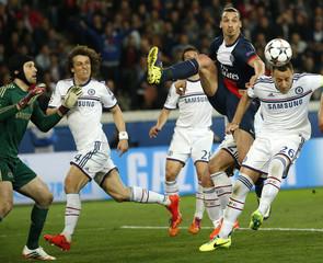 Paris St Germain's Ibrahimovic challenges Chelsea's Terry during their Champions League quarter-final first leg soccer match at the Parc des Princes Stadium in Paris