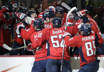 The Washington Capitals celebrate after a goal by Chimera against the Rangers in the second period of Game 1 of their NHL Eastern Conference quarterfinals hockey playoff series in Washington
