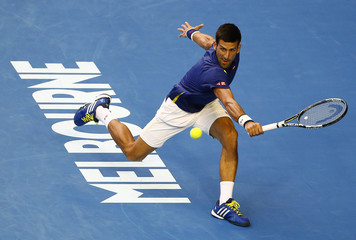 Serbia's Djokovic hits a shot during his quarter-final match against Japan's Nishikori at the Australian Open tennis tournament at Melbourne Park