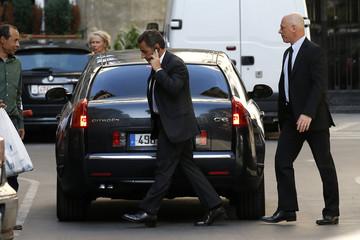 Former French President Nicolas Sarkozy speaks on his cellphone in Paris