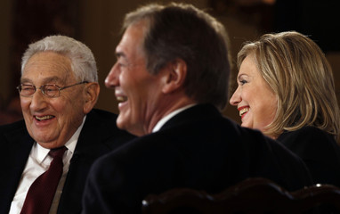 U.S. Secretary of State Clinton and former Secretary of State Kissinger appear with Charlie Rose in Washington