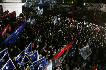 Supporters of Argentine President Fernandez celebrate after Fernandez won the presidential election at the Plaza de Mayo square in Buenos Aires