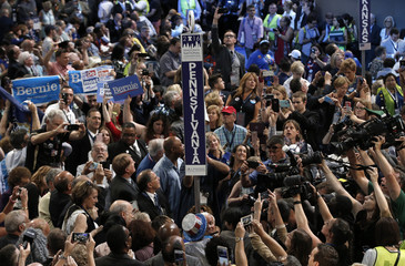 Pennsylvania delegates cheer during the roll call on the second day at the Democratic National Convention in Philadelphia