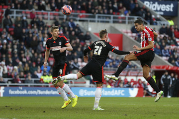 Sunderland's Rodwell heads the ball as Fulham's Christensen challenges during their English FA Cup soccer match at the Stadium of Light in Sunderland