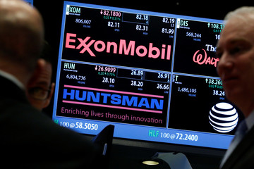 A screen displays trading information for Huntsman Corp. on the floor of the NYSE in New York,