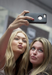 Model Gigi Hadid poses for a selfie during a promotional event for the 2015 Sports Illustrated Swimsuit issue in New York