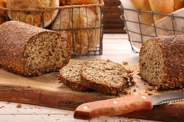 Whole grain bread on a wooden board