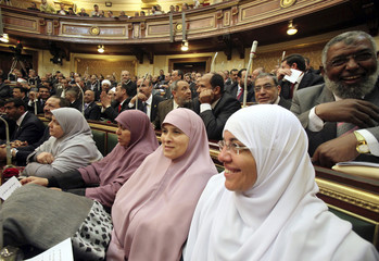 Female members of parliament, who are also members of the Freedom and Justice Party of the Muslim Brotherhood, attend the first Egyptian parliament session
