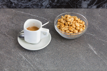 Cup of coffee and roasted nuts