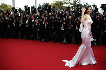 "Cast member Hilary Swank poses on the red carpet as she arrives for the screening of the film ""The Homesman"" in competition at the 67th Cannes Film Festival in Cannes"